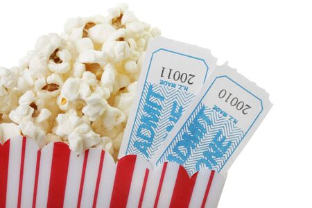 A cup of popcorn and two movie tickets, isolated on a white background. Stock Photo