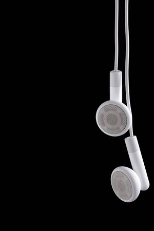 Modern portable audio ear phones on a black background.