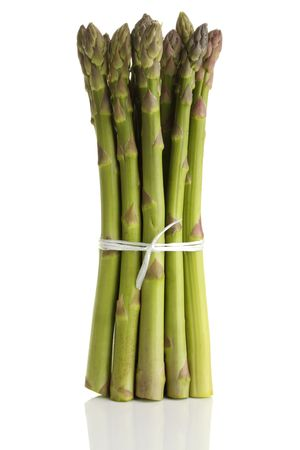A bunch of asparagus, tied and standing on a white background. Stock Photo - 5586384