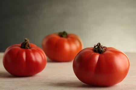 Three fresh, organically grown Heirloom tomatoes. photo