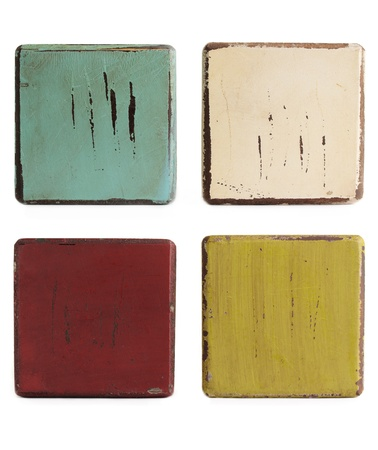 painted wood: Four grungy worn wooden blocks on a white background. Stock Photo