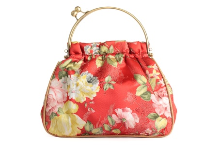 A floral pattern womens hand bag, isolated on a white background. photo