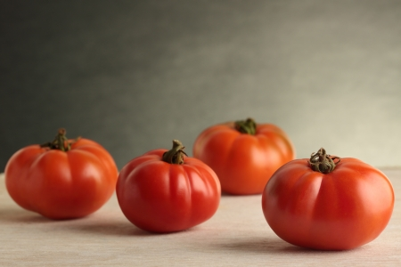 heirloom: Four fresh, organically grown Heirloom tomatoes. Stock Photo