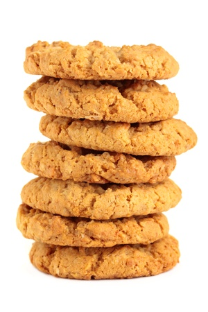 A stack of sweet biscuits, known in Australia as ANZAC biscuits. Isolated on a white background. photo