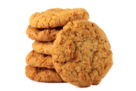 A stack of sweet biscuits, known in Australia as ANZAC biscuits. Isolated on a white background.