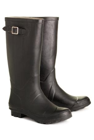 botas de lluvia: Botas de caucho negro en bruto, aislado en un fondo blanco