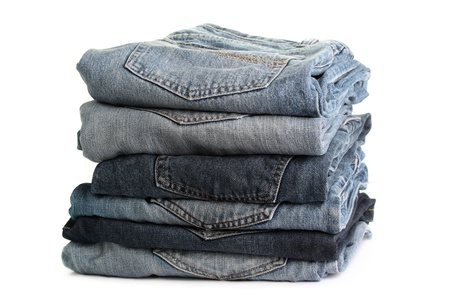 denim jeans: A stack of denim jeans, isolated on a white background.