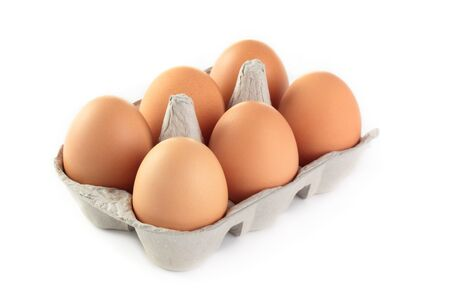 A carton of fresh freerange eggs on a white background. photo
