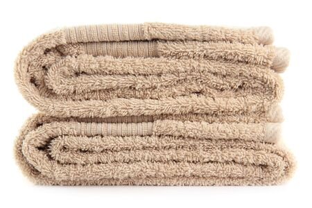 laundry pile: A stack of bath towels, isolated on a white background.
