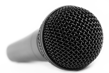 A black dynamic vocal microphone on a white background. photo