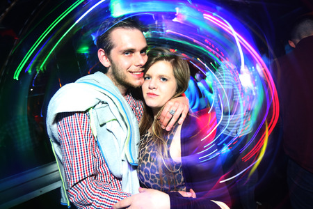 lazer: Club Portrait of 2 people with Lazer light in background