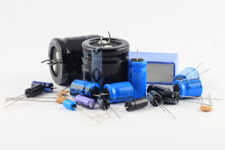 electronics parts: Pile of capacitors of varying sizes and farads