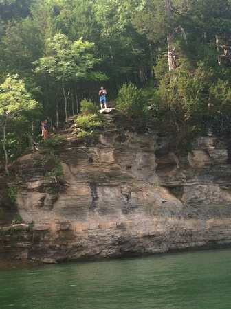 Cliff diving Im the beautiful lake