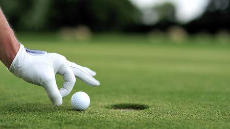 cheater: Man cheating playing golf Stock Photo