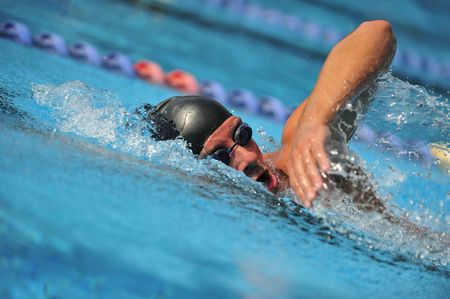 Swimmer competing Stock Photo