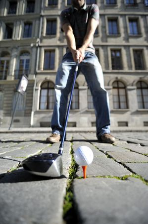 Man playing golf in the street