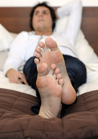 Man listening to the music on the bed photo