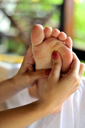acupressure hands: Reflexology foot massage, spa foot treatment  Stock Photo