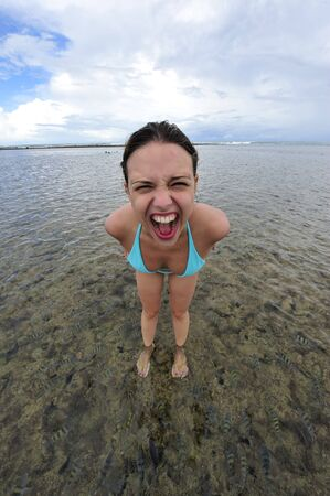 Woman screaming in the middle of the water Stock Photo - 4535248