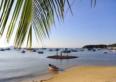 Beach in Buzios with men statues, Rio de Janeiro state, Brazil