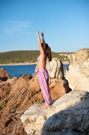 Beautiful young woman doing yoga exercise outdoors Stock Photo - 5430095