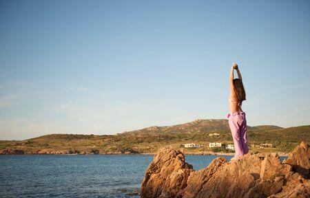 Beautiful young woman doing yoga exercise outdoors Stock Photo - 5426451
