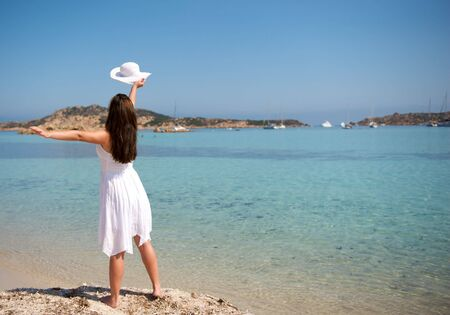 Pretty woman enjoying her vacation in Sardinia photo