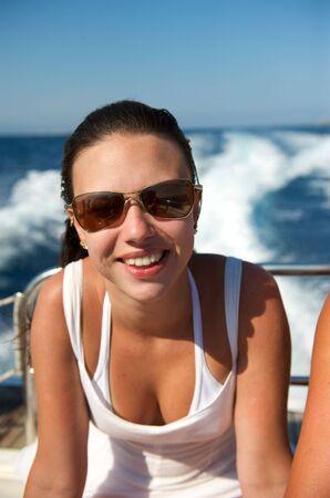 ady: Pretty girl enjoying her boat trip