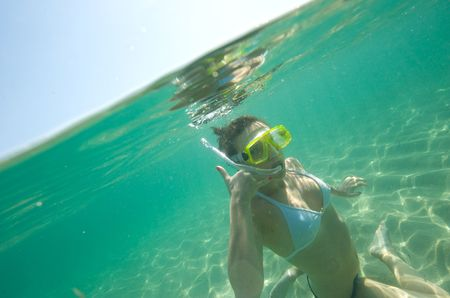 scuba goggles: Woman doing snorkeling with goggles and scuba