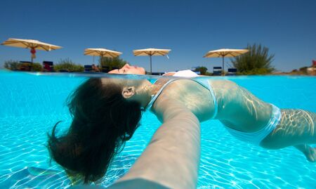 Underwater view of a woman swimming in the swimming pool Stock Photo - 5444012