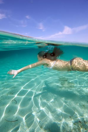 underwater woman: Underwater view of a woman swimming in the ocean