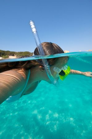 scuba goggles: Underwater view of a woman swimming in the ocean