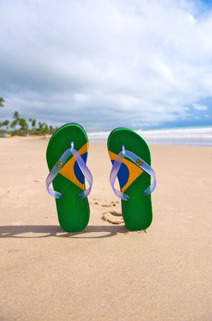 Brazilian flipflop with a coconut on the beach in Brazil photo