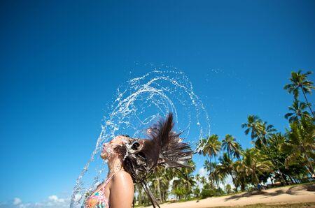 brazil beach swimsuit: Attractive woman playing in the ocean in Praia do Forte beach, Salvador de Bahia, Brazil