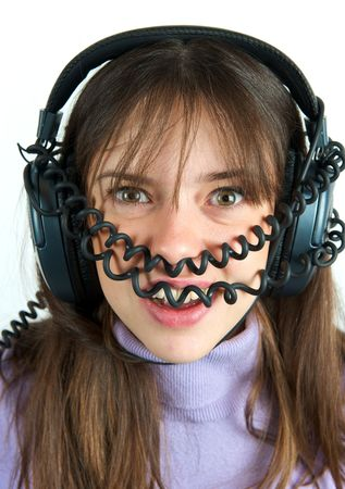 Pretty woman listening to music with headphone Stock Photo - 6317080