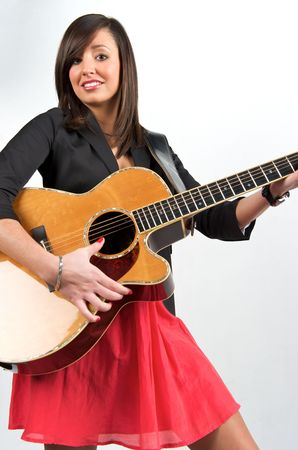 Pretty woman playing with guitar Stock Photo - 6502936