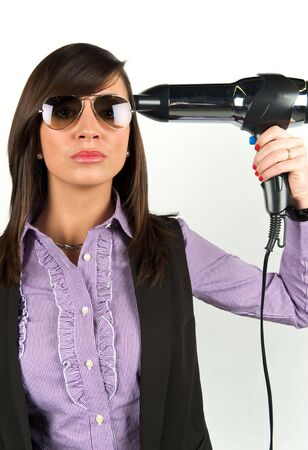 Young attractive woman with hairdryer Stock Photo - 6502961