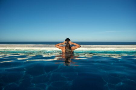 Woman relaxing in the spa swimming pool  photo