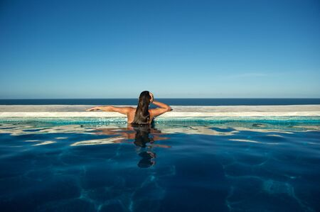brazil beach swimsuit: Woman relaxing in the spa swimming pool