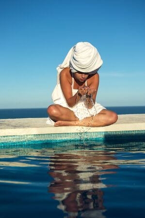 Woman relaxing in the spa swimming pool in Arraial dAjuda, Brazil photo