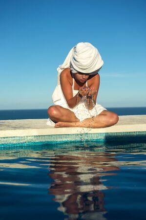 brazil beach swimsuit: Woman relaxing in the spa swimming pool in Arraial dAjuda, Brazil