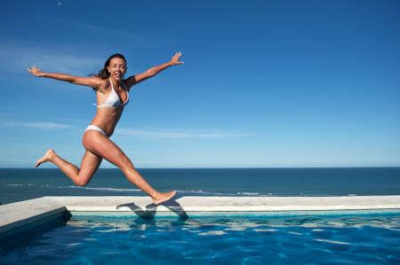 Woman relaxing in the spa swimming pool in Arraial dAjuda, Brazil photo