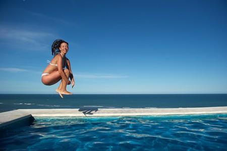 Woman relaxing in the spa swimming pool in Arraial dAjuda, Brazil