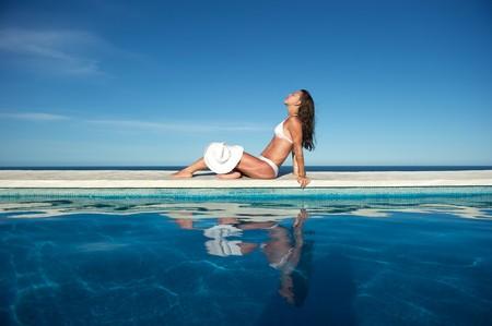 Woman relaxing in the spa swimming pool in Arraial d'Ajuda, Brazil