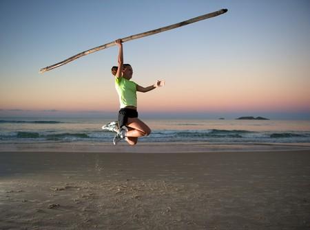 Woman doing exercises during sunset in Florianopolis, Santa Catarina, Brazil photo