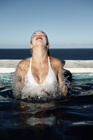 brazil beach swimsuit: Woman relaxing in a Spa swimming pool with sea view