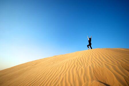 Woman enjoying the desert in Dubai, United Arab Emirates