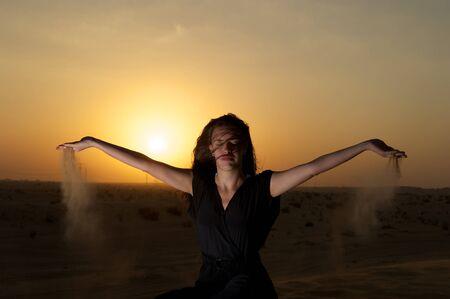 Woman enjoying the desert in Dubai, United Arab Emirates Stock Photo - 8664616