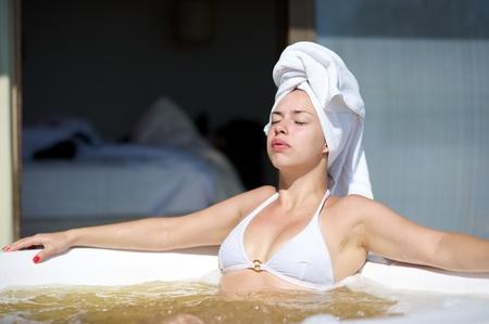 Woman relaxing in a jacuzzi in Porto Belo, Santa Catarina, Brazil photo