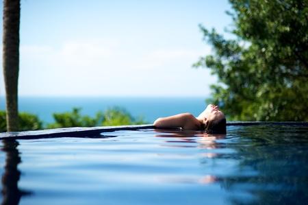 Woman relaxing in a paradise swimming pool in Porto Belo, Santa Catarina, Brazil